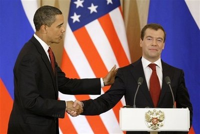 """A warm greeting from the President of Russia. President Medvedev later was heard to murmur: """"That dude scares me."""""""